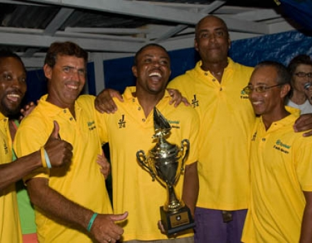 Sumptins Happ'nin crew celebebrating with the Southern Caribbean trophy for the J/24 class